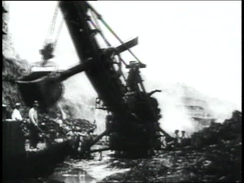 montage crane moving debris / republic of panama - anno 1906 video stock e b–roll