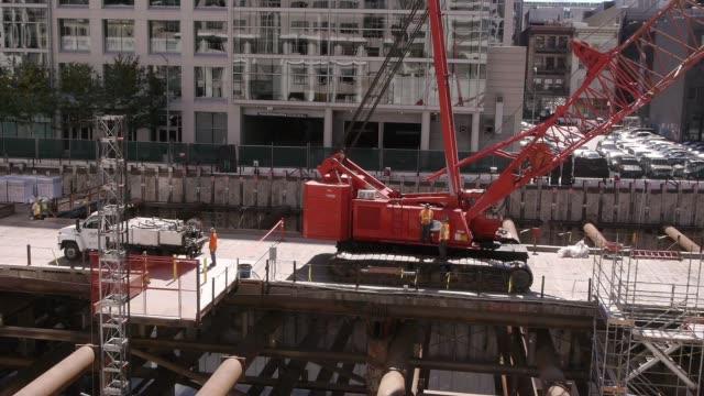 crane on contruction site. medium shot. - spoonfilm stock-videos und b-roll-filmmaterial