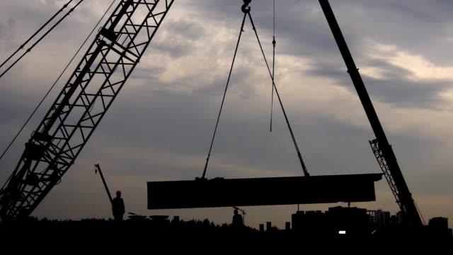 crane on site works, hoisting steel parts - picking up stock videos & royalty-free footage
