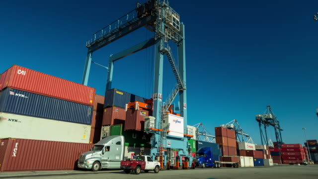 crane searching for shipping containers in yard - time lapse - long beach california video stock e b–roll