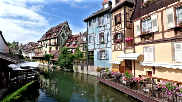 crane shot: colmar village cityscape alsace france in summer - france stock videos & royalty-free footage