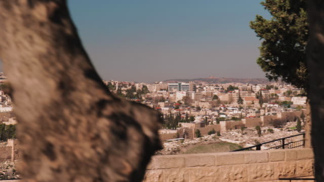 crane shot from the mount of olives overlooking the old town of jerusalem with the dome of the rock in the center perfect introductional shot for any... - crane shot stock videos and b-roll footage