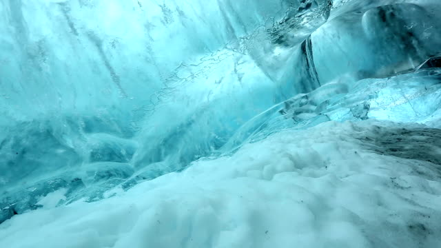 hd crane shot: ice cave at vatnajokull glacier jokulsaron iceland - cave stock videos & royalty-free footage