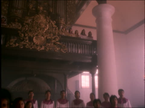crane shot of asian women's choir singing in ornate portuguese church / jakarta / indonesia - choir stock videos & royalty-free footage