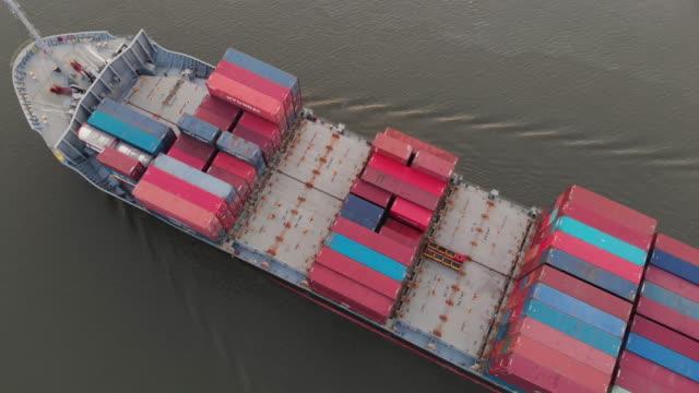 crane shot of container ship in sea - crane shot video stock e b–roll
