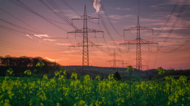 crane shot of electricity pylons at sunset - electricity stock videos & royalty-free footage