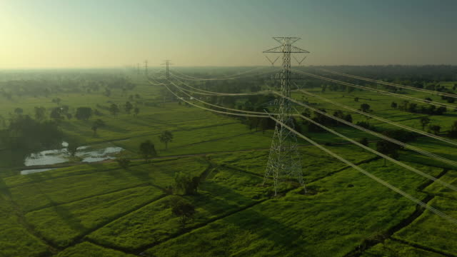 crane shot of electricity pylons with sunrise - electricity pylon stock videos & royalty-free footage