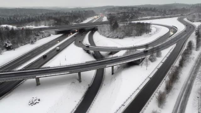 crane shot of freeway intersection during winter - crane shot stock videos & royalty-free footage