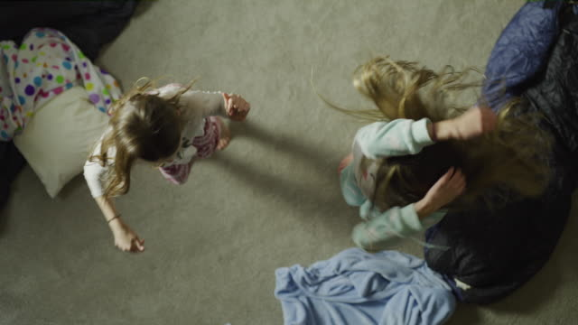 Crane shot of girls dancing during sleep over / Cedar Hills, Utah, United States
