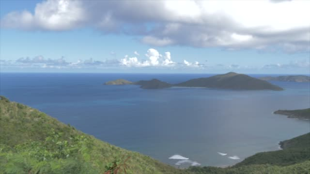 crane shot of north of tortola from ridge road with views of guana island, tortola, british virgin islands, west indies, caribbean, central america - クレーンショット点の映像素材/bロール