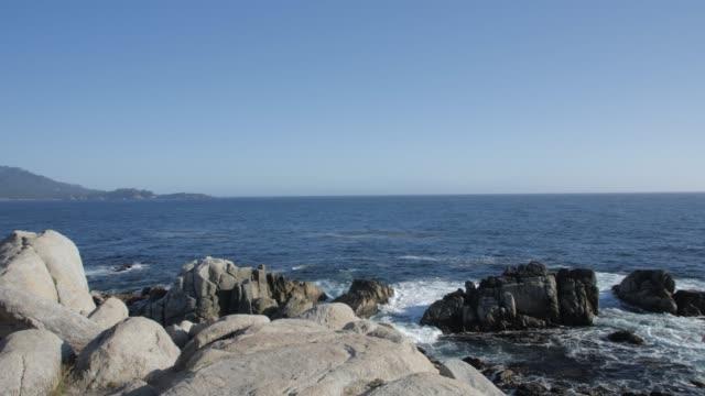 crane shot of pacific ocean and rocks on coastline of 17 mile drive, carmel, california, united states of america, north america - north pacific ocean stock videos & royalty-free footage