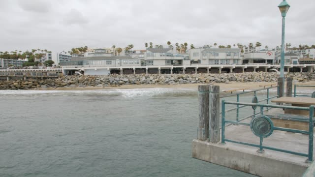 crane shot of pier and sea front at redondo beach, los angeles, la, california, united states of america, north america - crane shot stock videos & royalty-free footage