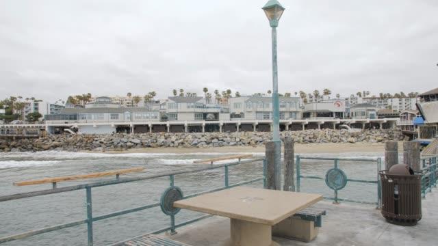 crane shot of pier and sea front at redondo beach, los angeles, la, california, united states of america, north america - kraneinstellung stock-videos und b-roll-filmmaterial