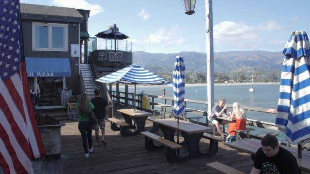 crane shot of restaurant at stearns wharf pier, santa barbara, california, united states of america, north america - santa barbara stock-videos und b-roll-filmmaterial