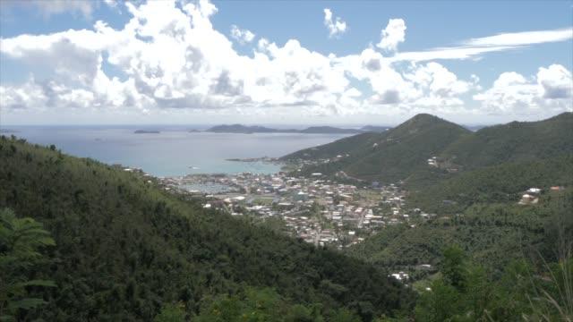 vídeos de stock e filmes b-roll de crane shot of road town from ridge road, tortola, british virgin islands, west indies, caribbean, central america - plano de grua