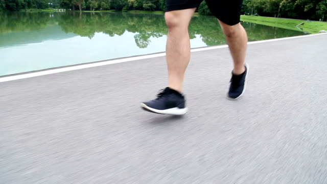 crane shot of runner from running shoes to head - crane shot stock videos & royalty-free footage