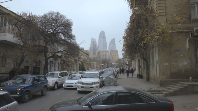 crane shot of the flame towers in baku, taken from a street in the old part of the city. - baku video stock e b–roll