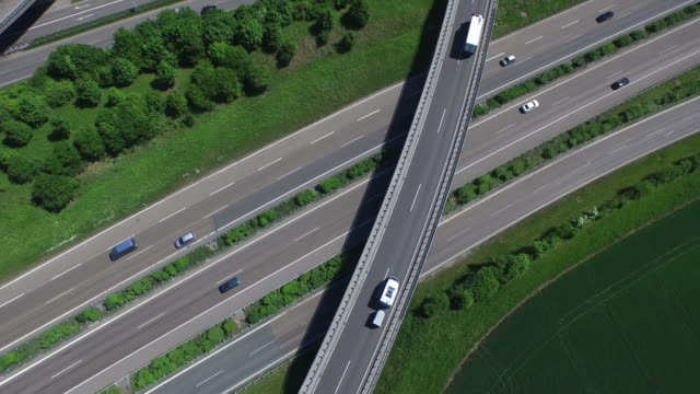 Crane shot of vehicles moving on highways
