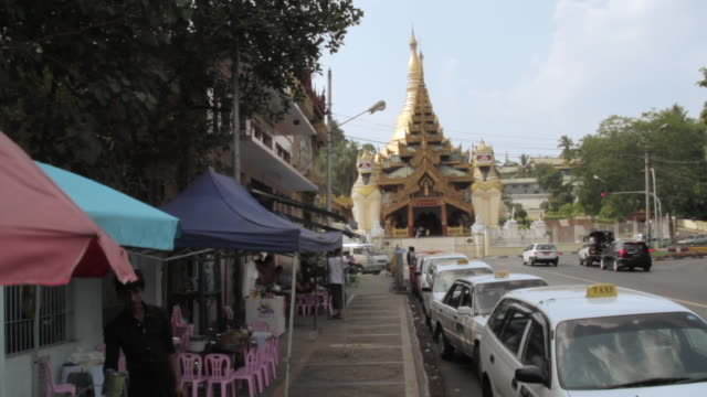 Crane shot over a street facing the Shwedagon Pagoda in Yangon.