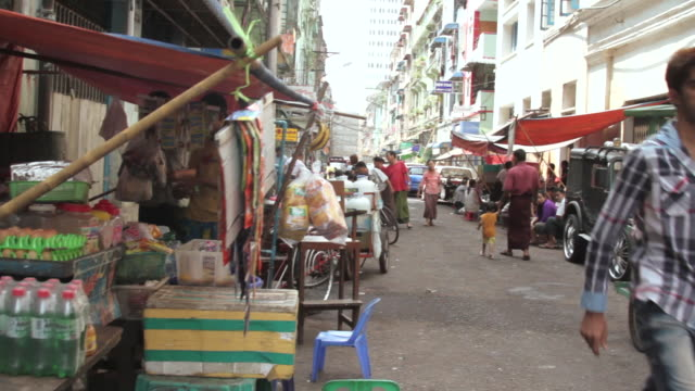 Crane shot over a street market in Yangon.