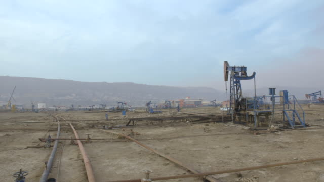 crane shot over an operational oil field near baku. - baku video stock e b–roll