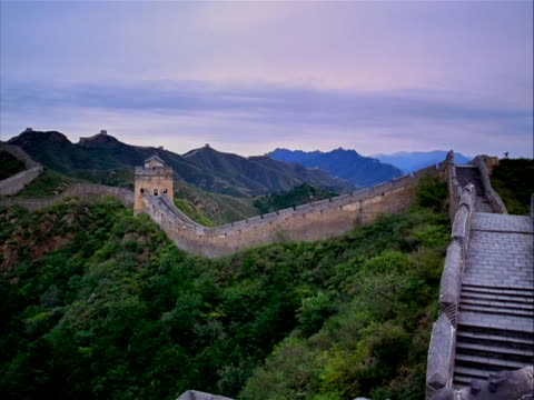 crane shot overlooking the great wall of china the great wall of china is a series of stone and earthen fortifications in northern china built... - crane shot stock videos & royalty-free footage