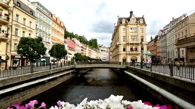 Crane shot: Pedestrian crowded at Karlovy Vary town square Czech Republic