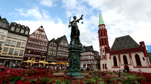 crane shot: pedestrian crowded at romerberg town square frankfurt germany - rathaus stock videos & royalty-free footage