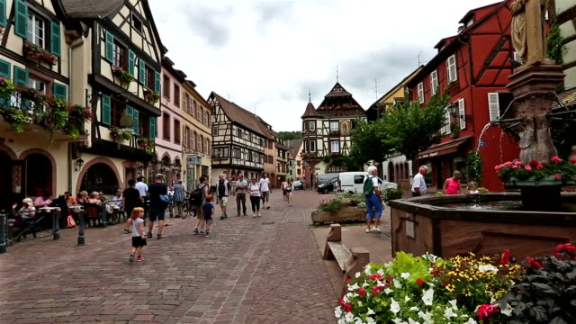 crane shot: pedestrian crowded kaysersberg village cityscape alsace france - lorraine stock videos & royalty-free footage