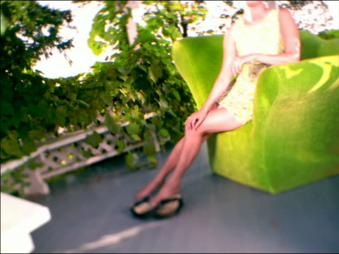 stockvideo's en b-roll-footage met canted crane shot selective focus portrait asian woman smiling + sitting in gazebo with ivy - gazebo
