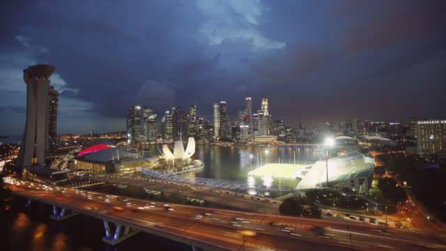 ws tl ha crane shot, singapore city skyline and marina bay sands hotel  - crane shot stock videos and b-roll footage