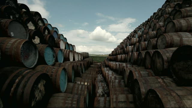 "crane shot stacks of oak barrels for whisky - ""bbc universal"" stock videos & royalty-free footage"
