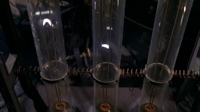 crane shot tilt up glass tubes with sparks inside (jacob's ladder) in frankenstein's laboratory / low angle tu - sparks stock videos & royalty-free footage