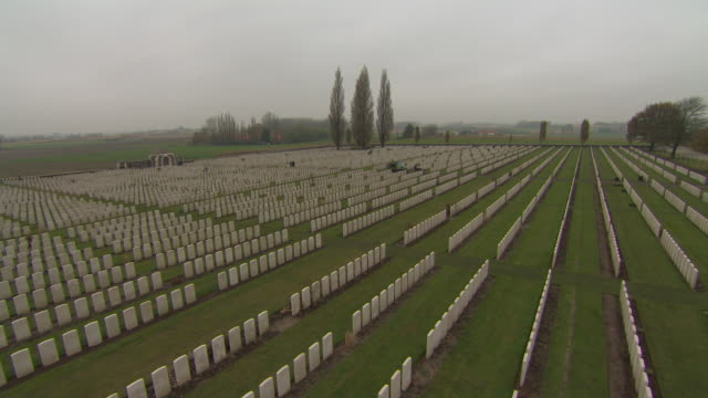 crane shot which lifts up to reveal rows and rows of wwi graves in tyne cot commonwealth war graves cemetery belgium fkaz191x clip taken from... - crane shot stock videos and b-roll footage