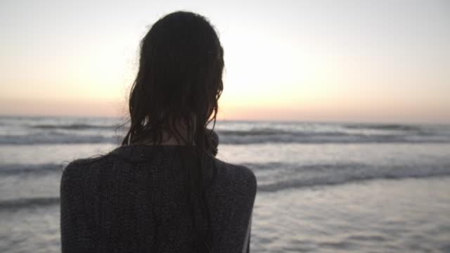 cu rv crane shot young woman on the beach - crane shot stock videos & royalty-free footage