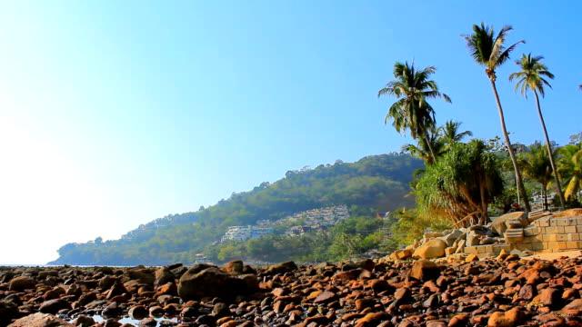 crane shot:beautiful beach with rock - crane shot stock videos & royalty-free footage