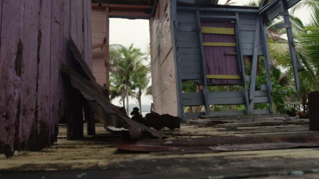 crane through hurricane damaged gift shop, belize - damaged stock videos & royalty-free footage