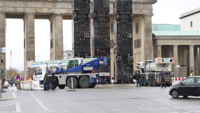 A crane truck leaves the Brandenburg Gate after the installation has been set up GermanSyrian artist Manaf Halbouni attends the installation of his...