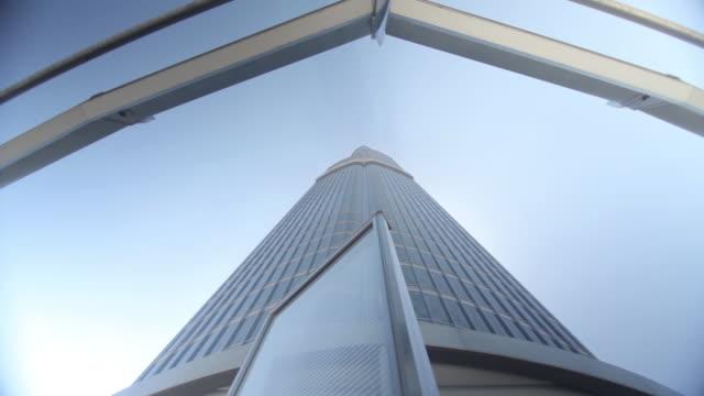 Crane up the exterior of a skyscraper in Dubai.