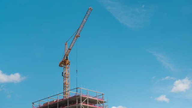 Crane Working at Construction Site Time Lapse