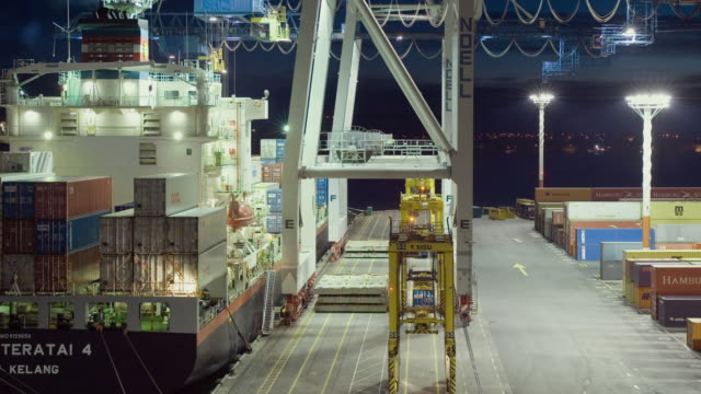 tl ha ws cranes and straddle carriers unloading container ship at night at ports of auckland as dawn turns to day/ auckland, new zealand  - dawn to day stock videos & royalty-free footage