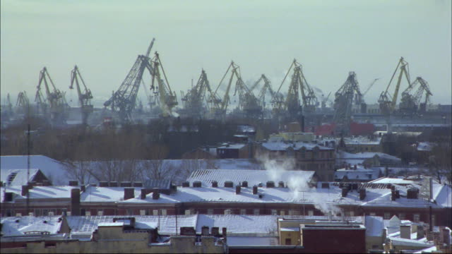 Cranes cover an industrial lot in St. Petersburg, Russia.