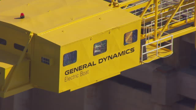 ms aerial pov cranes in warehouse/ groton, connecticut, united states - groton connecticut stock videos & royalty-free footage