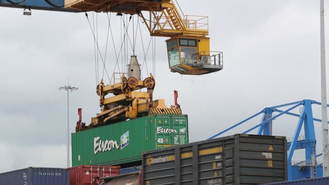 cranes lifts shipping containers from the freight rail yard at duisport ditterminal operated by duisburger hafen ag in duisburg germany on thursday... - crane stock videos & royalty-free footage