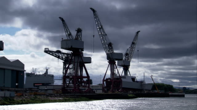Cranes line a jetty at Glasgow dockyard. Available in HD.