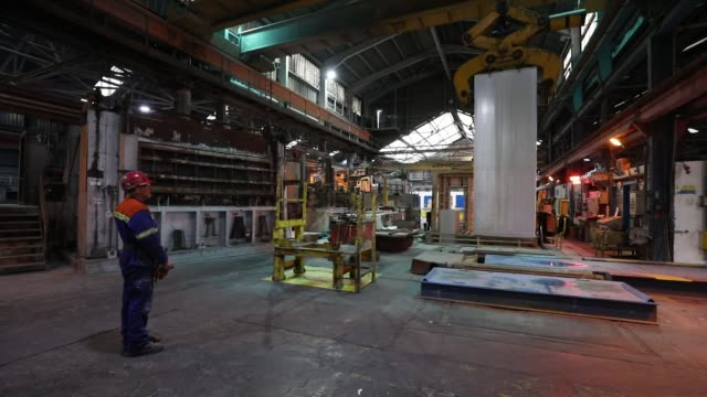 stockvideo's en b-roll-footage met cranes move aluminum ingots at the lochaber aluminum smelter operated by liberty house group in fort william uk on monday feb 6 2017 - aluminium