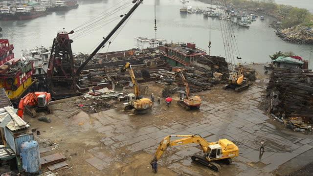 wa ha cranes moving scrap metal in shipyard - crane construction machinery stock videos & royalty-free footage
