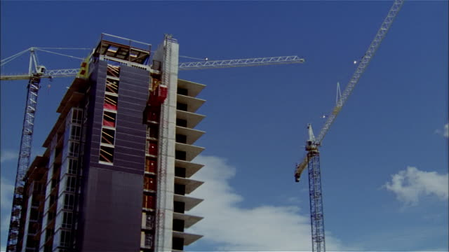 cu, pan, la, cranes next to building in construction  - unknown gender stock videos & royalty-free footage