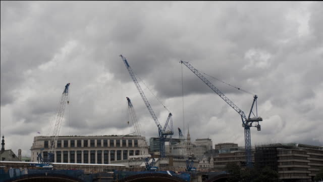 cranes on construction site at blackfriar's bridge, london, england, uk, timelapse - western european culture stock videos & royalty-free footage