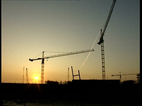 wa cranes on construction site at sunset - crane construction machinery stock videos & royalty-free footage
